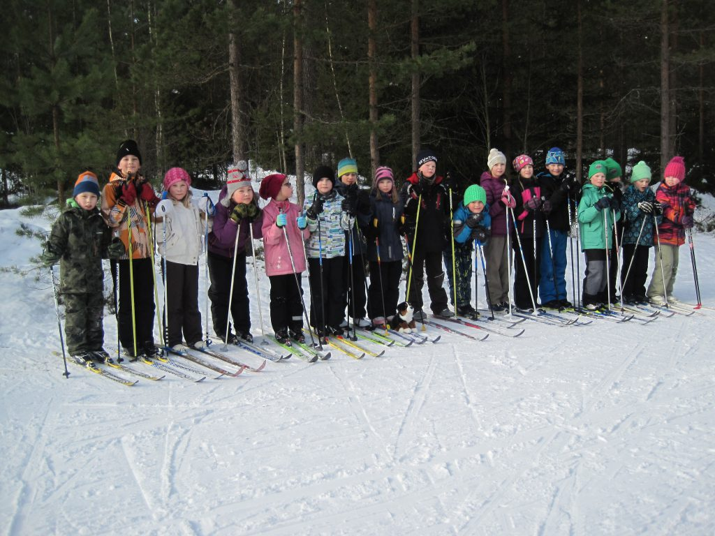 Difi tries our camera and snaps a group photo of the skiers